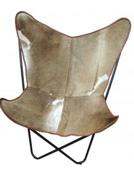 Vlinderstoel met beige koeienvel